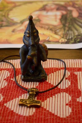 Statue and picture of Freyr, a deity to whom the author is dedicated. / Photo courtesy of Kristen Nereis (used with permission)