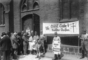 SA men holding German Christian propaganda during church elections in Berlin, 1933