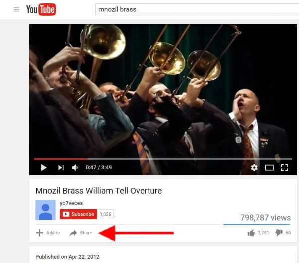 """Screenshot of YouTube video with arrow pointing to """"Share"""" icon"""