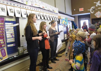 St. Olaf students work to help students at Prairie Creek Elementary School create an original opera.