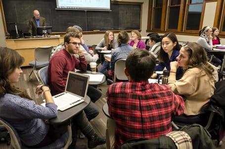 St. Olaf students (clockwise, from top left) Evan Davis '15, HaYe Jun '16, and Megan Jekot '16 work with Carleton students during class.