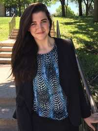 Emily Hynes '18 poses for a photograph in front of stairs on campus.