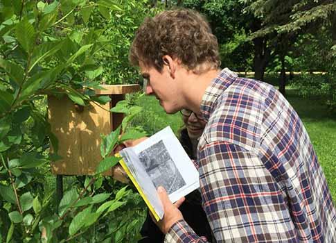Robby Holmes '18 checks bluebird trail houses.