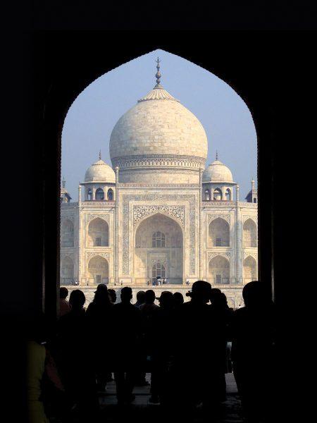Photo of the Taj Mahal mausoleum as viewed through the entrance gate.