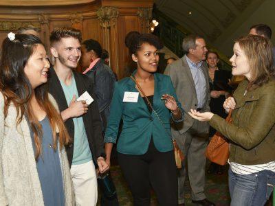 Students speak with alumni.