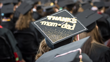 """Mortarboard with """"Thanks Mom & Dad"""" written on the top"""