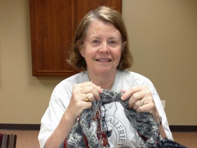St. Olaf College Professor of Norwegian Margaret Hayford O'Leary pictured knitting.