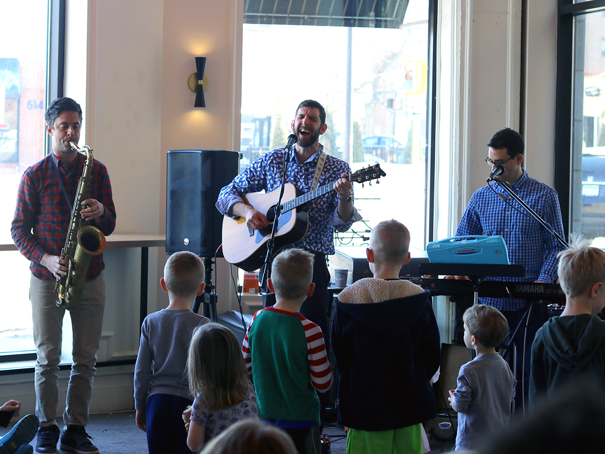 Musicians performing live for children.
