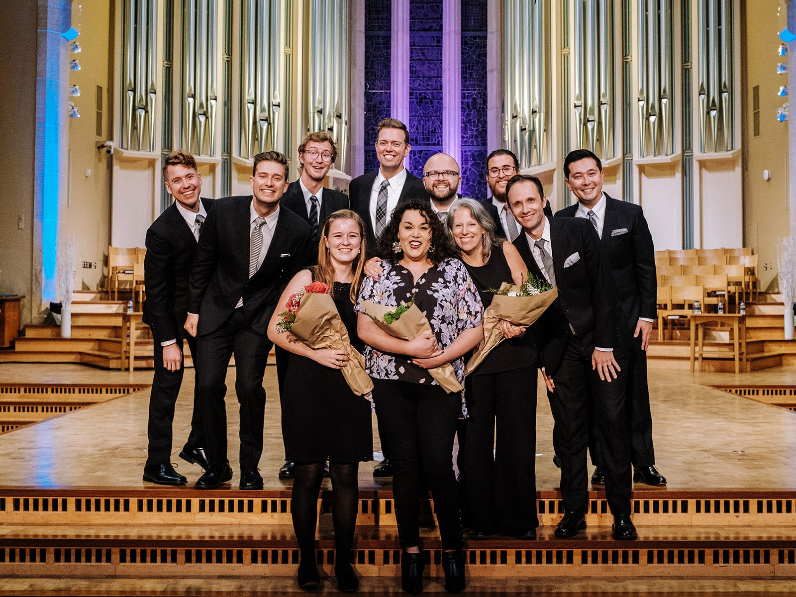 Grace Brigham '20 poses with Cantus after the performance. Photo by Steven Garcia '20.