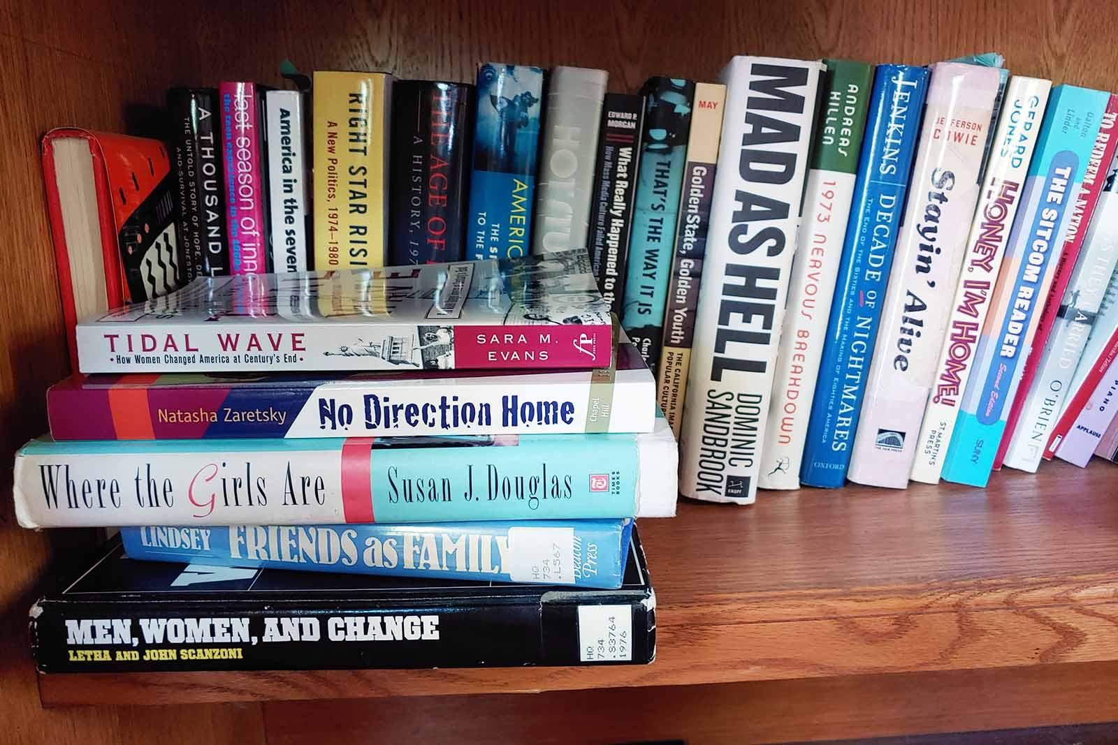 Just some of the books that Professor of History Judy Kutulas has read line the bookshelf underneath the desk in her study.