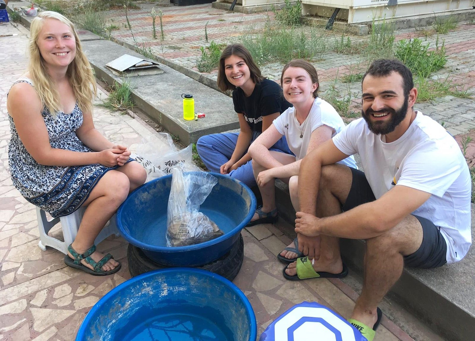 The team with a reconstructed amphora (wine vessel) that they discovered in their unit.