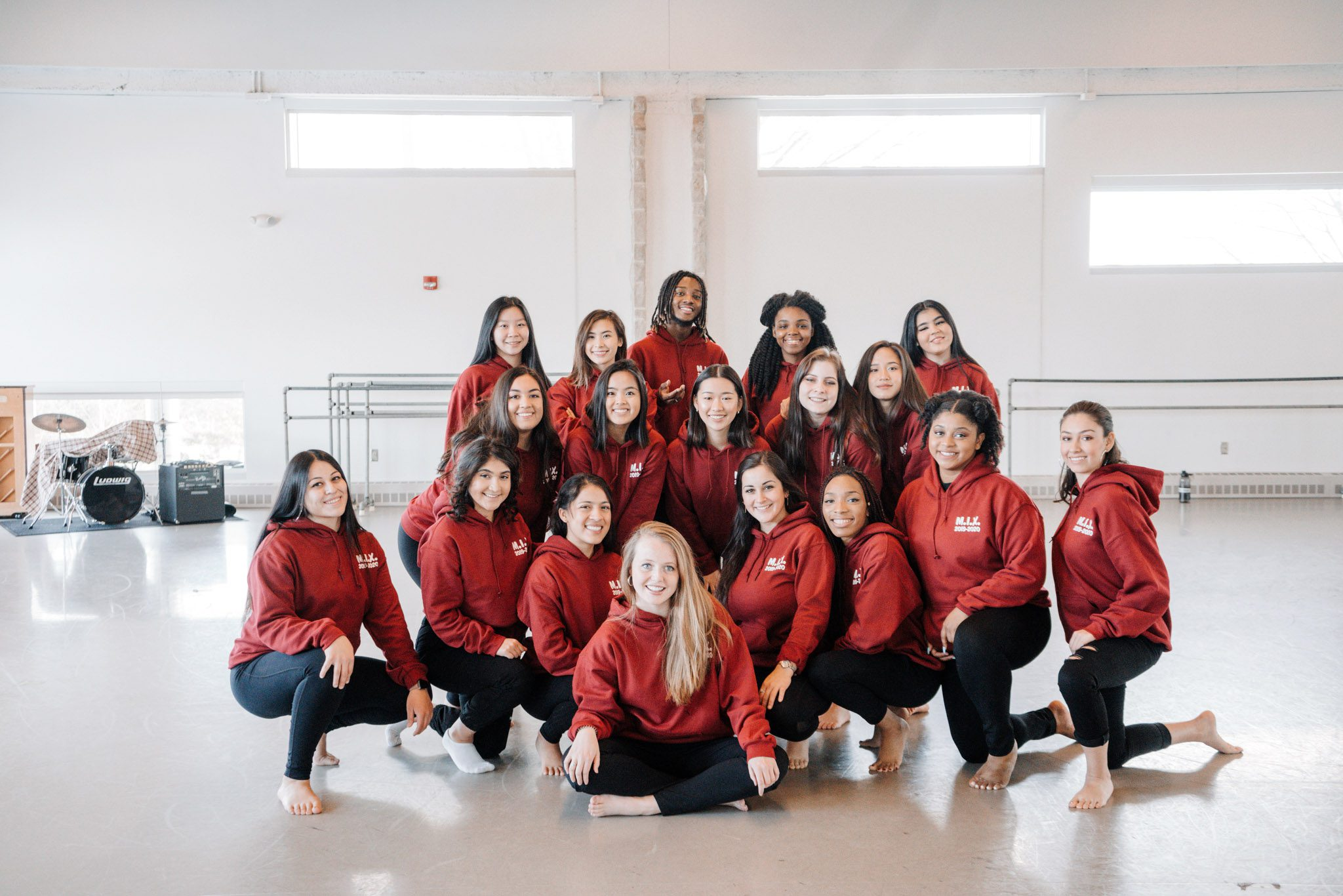 Portrait of M.I.X. members in a dance studio.