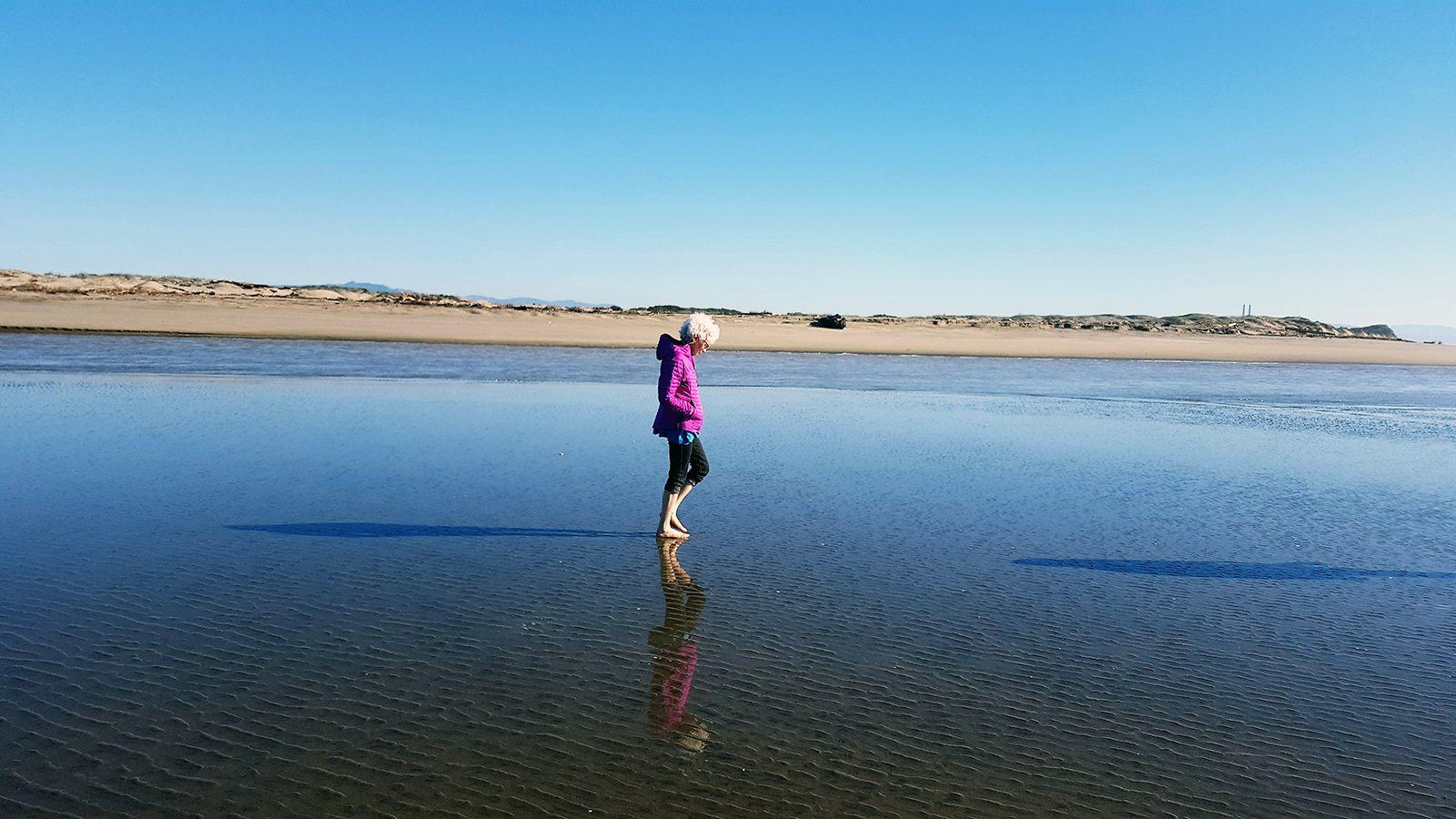 Professor of History Judy Kutulas walks the beach.