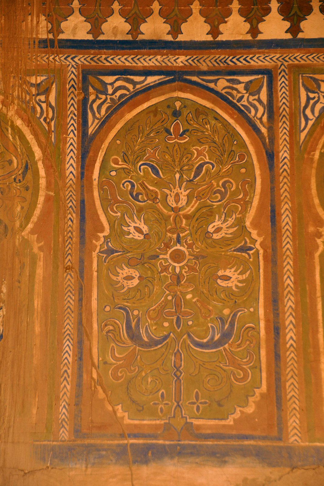 Photo of an intricately painted orange door in Morocco.