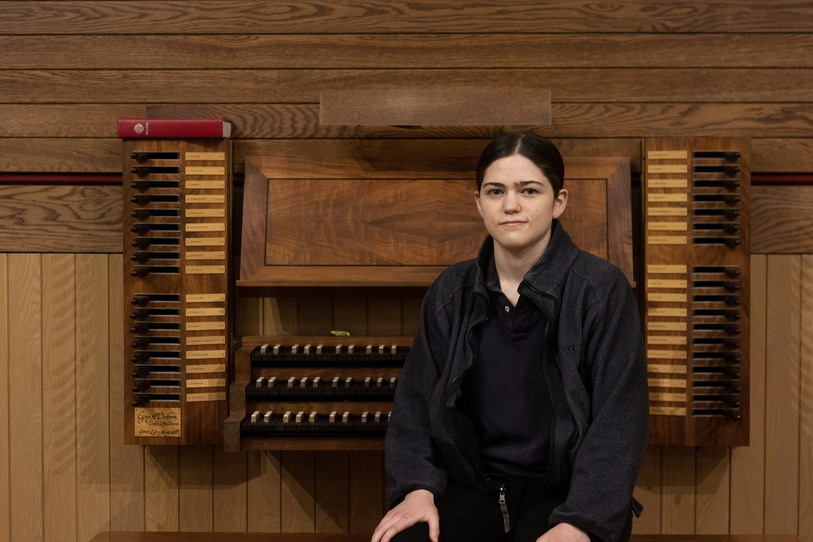 Portrait of Sarah Palmer in front of an organ.