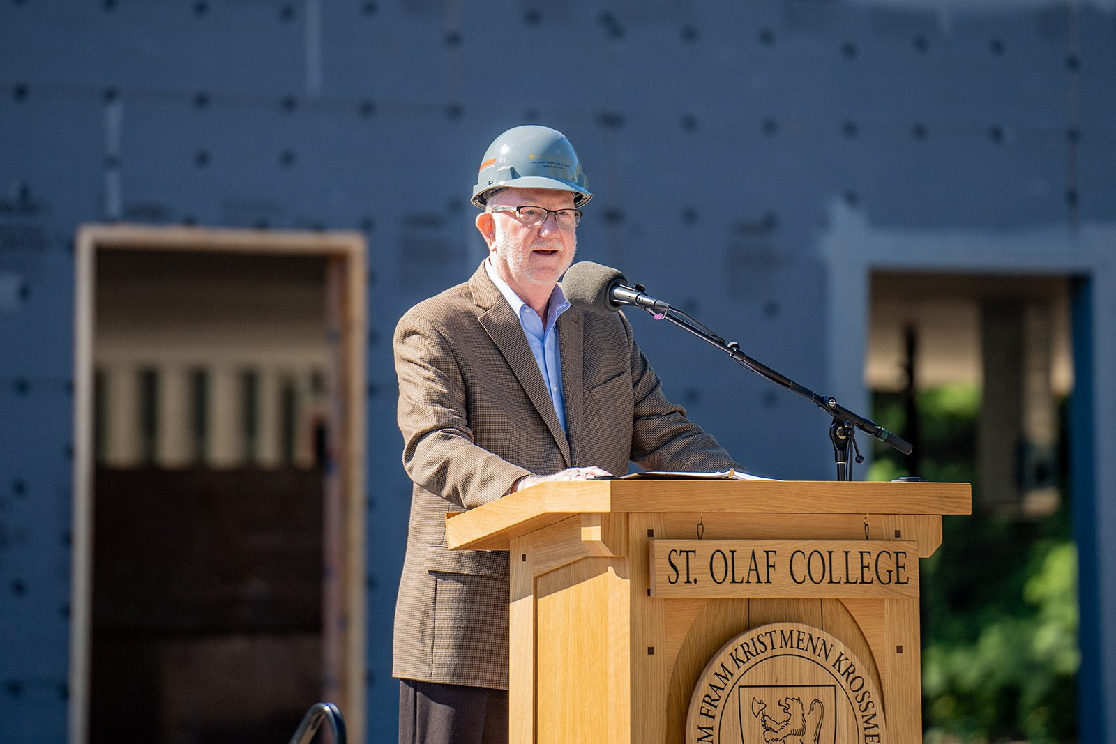 St. Olaf President David R. Anderson '74 speaks at the topping out ceremony for the new residence hall.