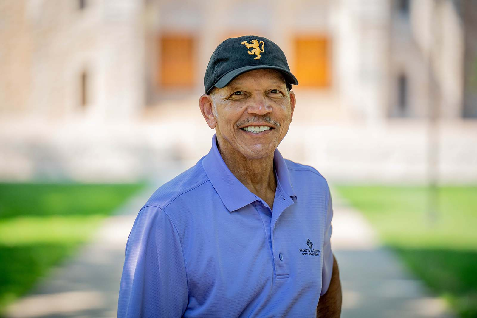 Former St. Olaf Regent Ron Hunter '70 pauses on campus in front of Boe Memorial Chapel for the Class of 1970's 50th Reunion. As a student, he co-founded the Cultural Union for Black Expression to educate Oles about Black culture and history in America. Recently he included a scholarship for CUBE members in his estate to pay forward the support he received and to continue advancing diversity, equity, and inclusion at St. Olaf.
