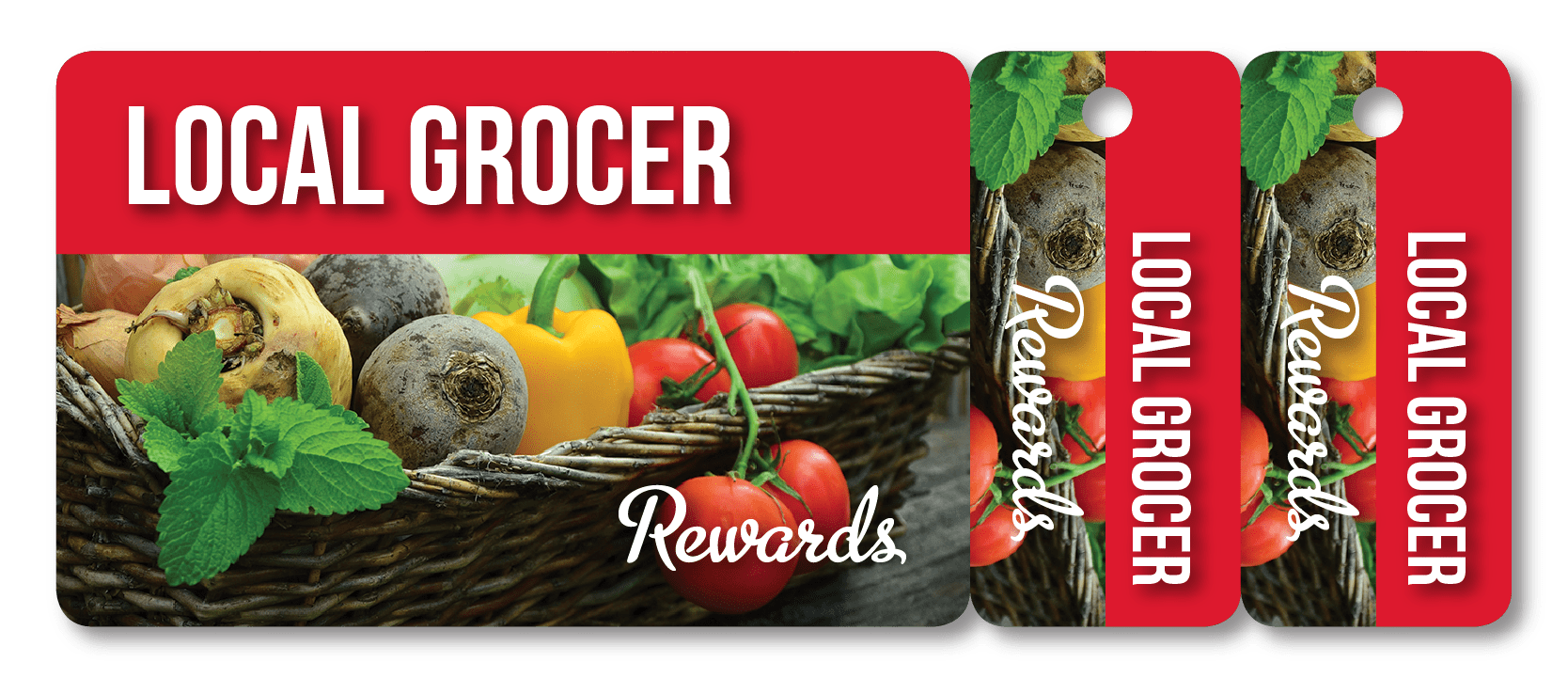 Grocery rewards card with two attached key tags showing a basket of fresh produce
