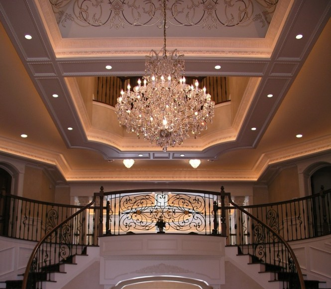 A Classic Wedding Cake Style Chandelier Shines In An Entryway Photo Via Schill Architecture