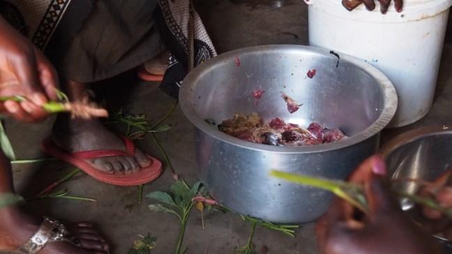 Washing goat meat