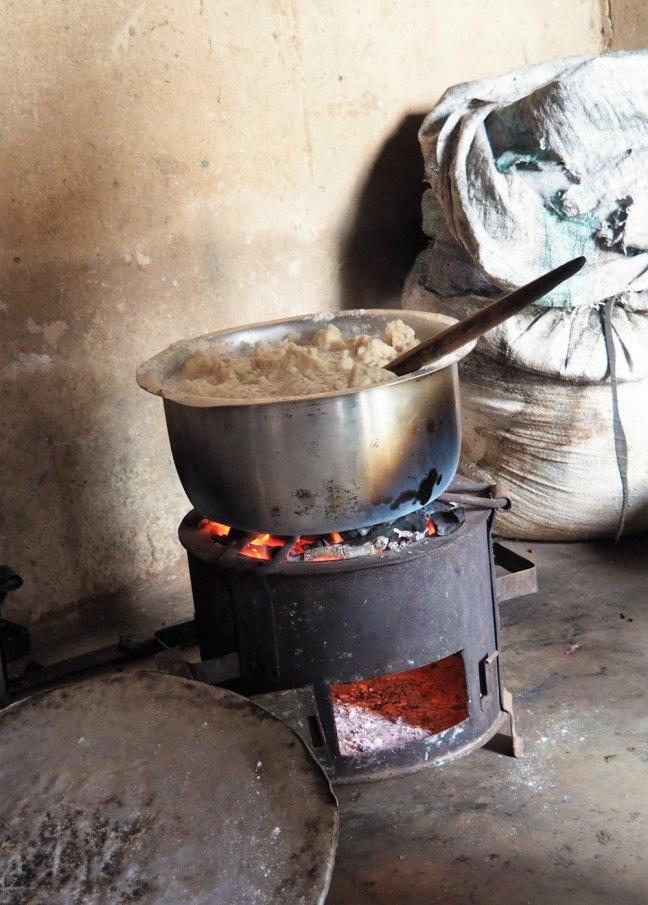 Ugali cooking on charcoal stove