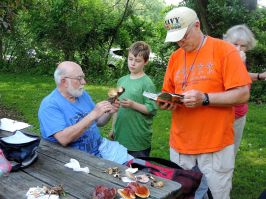 Jim Wasik and Jim Wilson identifying fungi.