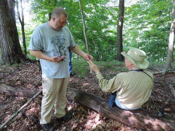 John Plishke III and Dick Dougall look at Laccaria amethystina specimens. By Adam Haritan.