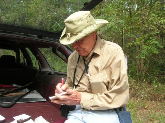 Dick Dougall writing an ID slip