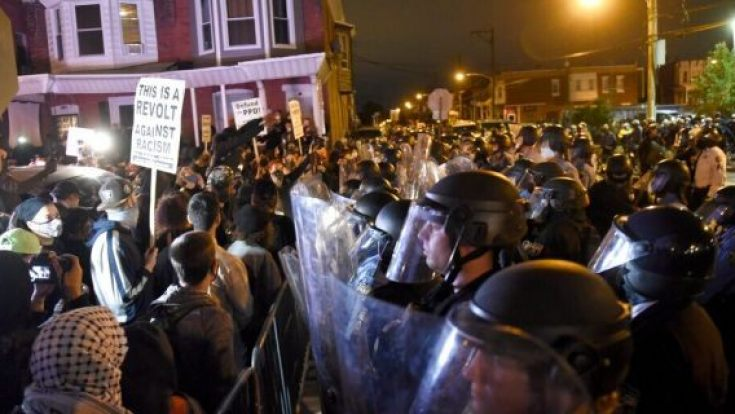 Protesters face off with police during a demonstration Tuesday, Oct. 27, 2020, in Philadelphia. (AP Photo/Michael Perez)