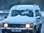 A car covered in snow is seen driving in wintery conditions near Craigellachie, Moray on November 30 2015.  Storm Clodagh has brought high winds and snow showers which covered the north of Scotland.