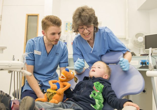 Dr Morag Curnow with Connor John, and his father, dental nurse, Nathan John.