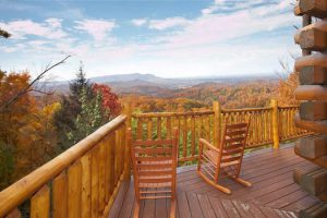 A deck with rocking chairs overlooking the Great Smoky Mountains