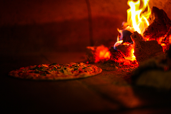 a pizza in a wood fired oven
