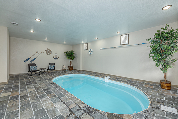 an indoor pool in a cabin in pigeon forge - Alpine Adventure