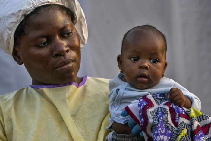 Two-month-old Lahya Kathembo is carried by a nurse waiting for test results at an Ebola treatment center in Beni, Congo, July 17, 2019.
