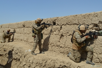 Afghan security forces take position during a battle with Taliban insurgents in Kunduz province, Afghanistan, Sept. 1, 2019.