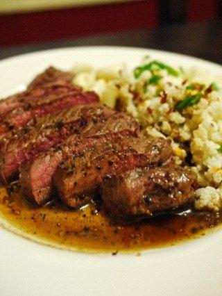 A lean peppered steak with a cauliflower \