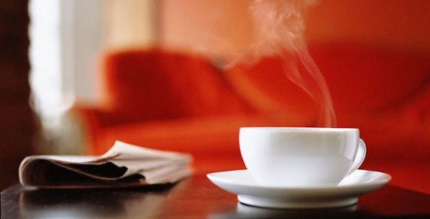 Coffee Cup on Table --- Image by © Michael Prince/CORBIS