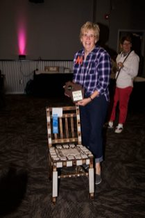 Raymond Zika of Crossroad Care Center took Best of Show for his wooden chair. Martha Bechard (shown) entered his piece.