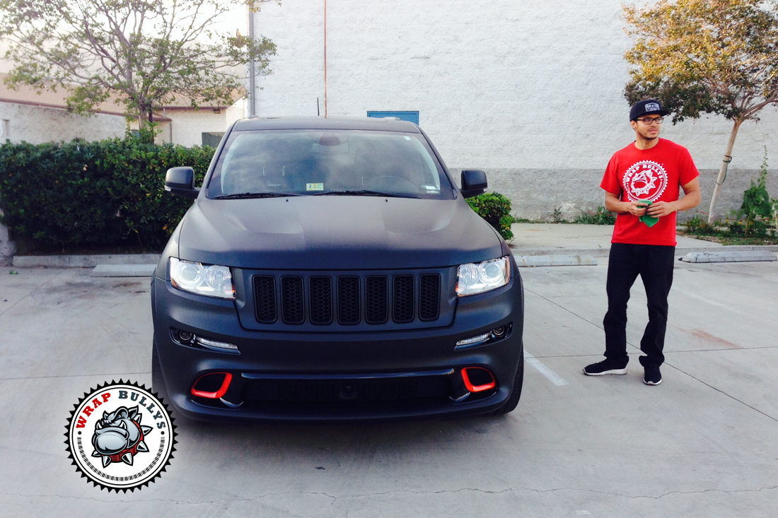 We used 3M deep matte black to wrap this jeep SRT8. Call us today for pricing.