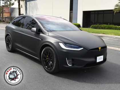 Matte Black Tesla X with Yellow Accents