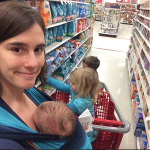 Image result for pulling shopping trolley while babywearing