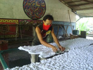 The fabric is prepared for dyeing and crumpled carefully on the table, ready for the first color application.