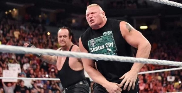 wwe-raw-undertaker-brock-lesnar-low-blow-642x330