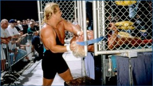 Hennig about to smash Flair's head with the cage door at Fall Brawl '97.