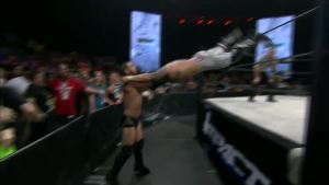 Davey Richards hitting the suicide dive on Austin Aries.