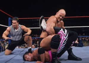 Steve Austin controlling Bret Hart at Mania.