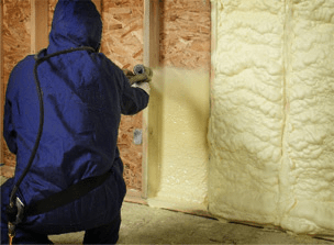 Insulating upscale log cabin with closed-cell spray foam.