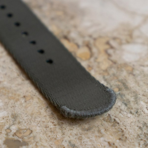 Stiched-end-seal-gray-wrist-hardware-welted-end