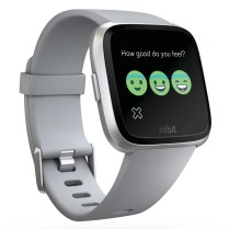 Product render of Fitbit Versa in 3 quarter view in gray and silver showing mood log on screen